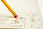 Pencil with eraser on exercise book — Stock Photo