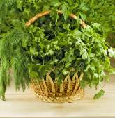 Image of many herbs in a basket on the table — Stock Photo