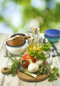 Image of  herbs, vegetables and utensils — Stock Photo
