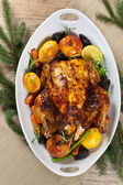 Whole Roasted holiday chicken with apples — Stock Photo