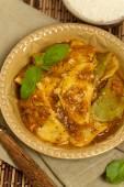 Ravioli with tomato sauce and parmesan cheese — Stock Photo