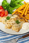 Fish dish - fried fish fillet with vegetables — Stock Photo