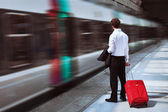 Businessman at the train station — Stock Photo