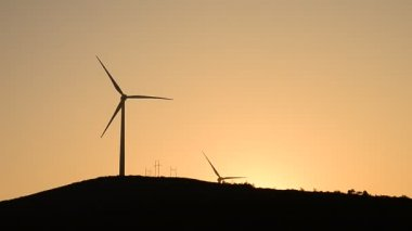Wind turbines in the country side at evening — Stock Video