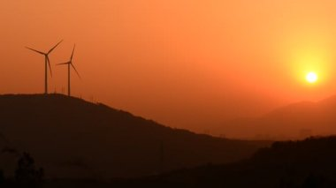 Wind turbines in the country side at evening — Vidéo