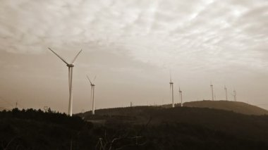Wind turbines in the country side at evening — Vídeo de Stock