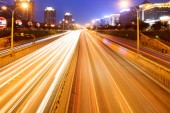 Cars in highway with blur motion — Stockfoto