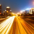 The light trails on the modern building background in shanghai china — Stock Photo #60981045