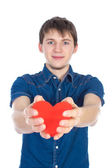 Handsome brunette mans holding a red heart, isolated on white background — Fotografia Stock