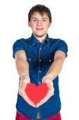 Handsome brunette mans holding a red heart, isolated on white background — Stock Photo