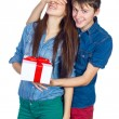 Happy Man giving a gift to his Girlfriend. Happy Young beautiful Couple isolated on a White background. — Stock Photo #65945311