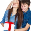 Happy Man giving a gift to his Girlfriend. Happy Young beautiful Couple  isolated on a White background. — Stock Photo #65945415