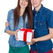 Happy Man giving a gift to his Girlfriend. Happy Young beautiful Couple  isolated on a White background. — Stock Photo #65945629