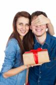 Happy Young beautiful Couple  isolated on a White background with gift in hand — Stock Photo