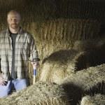Male farmer in hay barn — Stock Photo #52026613