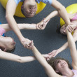 Exercise group grabbing hands — Stock Photo #52026647