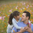 Girl hugging her father in field of flowers — Stock Photo #52026851