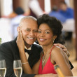Couple smiling for the camera at dinner table — Stock Photo #52027191