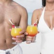 Couple having tropical drinks at the beach — Stock Photo #52027299