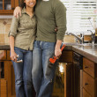 African couple installing kitchen sink — Stock Photo #52027527