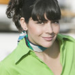 Hispanic woman wearing scarf around neck — Stock Photo #52027553