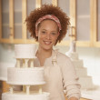 African female baker next to a wedding cake — Stock Photo #52027843