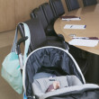 Baby in stroller next to conference table — Stock Photo #52028137