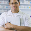 African American male pharmacist with chart — Stock Photo #52028915