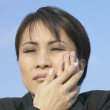 Asian businesswoman with toothache — Stock Photo #52029017