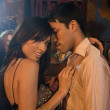 Multi-ethnic couple dancing at nightclub — Stock Photo #52029463