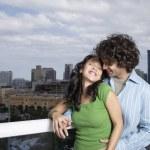 Hispanic couple hugging on balcony — Stock Photo #52029661