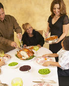 Hispanic family at holiday dinner table — Stock Photo