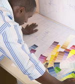 Male architect viewing color swatches — Stock Photo