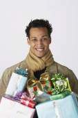 Young man with gifts — Stock Photo