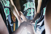 Girl's hands in team huddle — Stock Photo