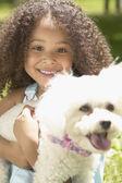 African girl holding dog — Stock Photo