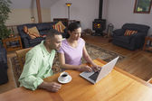 Couple working on laptop — Stock Photo