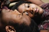 Couple laying head to head — Stock Photo