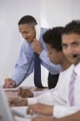 African businessman talking on telephone — Stock Photo
