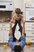 Dad after Work with Toddler on Feet — Stock Photo