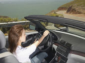 Woman driving convertible — Stock Photo