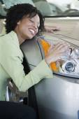 Woman hugging her car — Stock Photo
