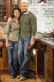 African couple installing kitchen sink — Stock Photo