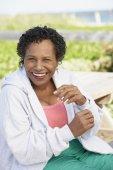 Senior woman laughing outdoors — Stock Photo