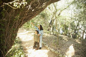 Hispanic mother and son on nature trail — Stock Photo