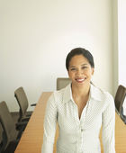 Businesswoman smiling in conference room — Stock Photo