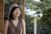 Asian woman wearing safari hat — Stock Photo