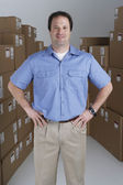 Male warehouse worker in warehouse — Stock Photo