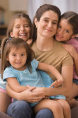 Mother with three daughters — Stock Photo