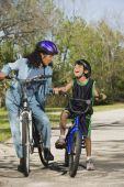 Mother and son on bicycles laughing — Stock Photo